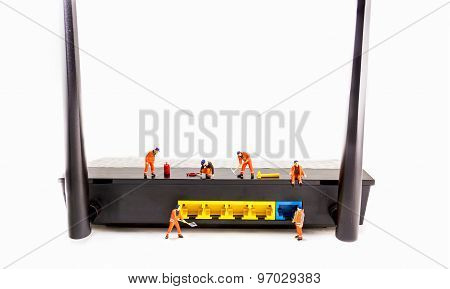 Image Of Mini Figure Dolls Engineer Fix Internet Wifi Router  Isolated On White Background.