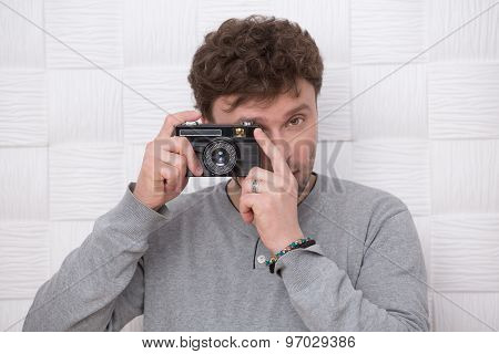 Handsome man with photocamera