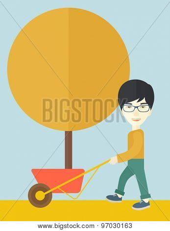 A young japanese man pushing the cart with orange tree. Business growth concept. A Contemporary style with pastel palette, soft blue tinted background. Vector flat design illustration. Vertical layout