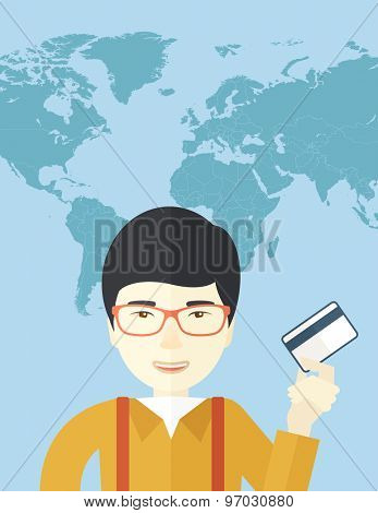 A happy japanese businessman thankfully standing holding his credit card. Fulfillment concept. A contemporary style with pastel palette soft blue tinted background. Vector flat design illustration