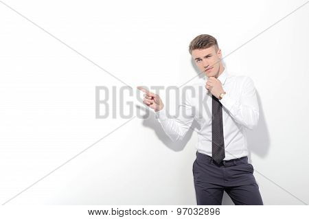 Businessman pointing aside with index finger