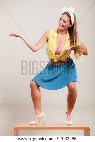 Pin Up Girl Dancing On Table With Empty Hand Palm.