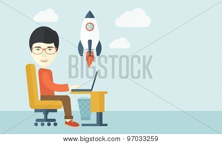 An asian man sitting with his laptop is searching for a new business project. Start up business concept. A contemporary style with pastel palette soft blue tinted background with desaturated clouds