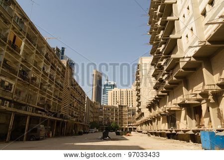 Modern buildings and poor apartments