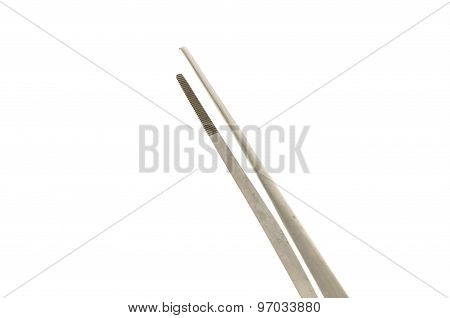 Metal Tweezers Isolated Over The White Background