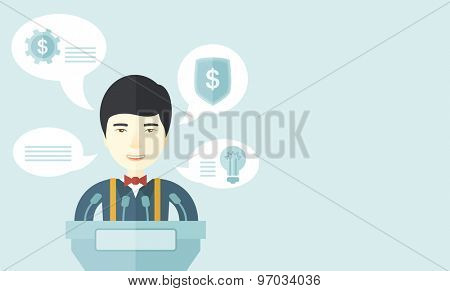 A chinese speaker stands behind a podium with microphones makes a business report  and marketing strategy inside the conference room. Presentation, reporting concept. A Contemporary style with pastel