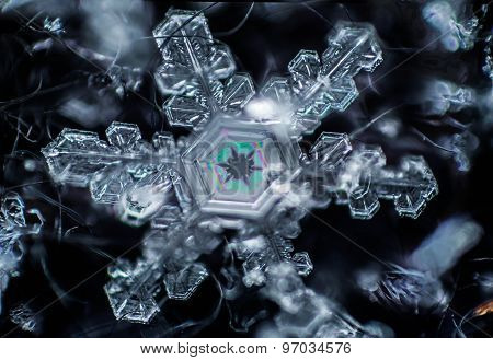 Thin Film Interference on a Snowflake