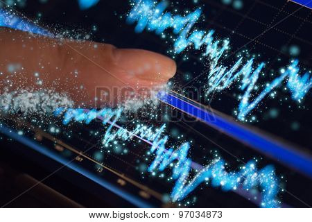 Finger and phone with finance statistic