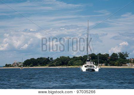 Luxury White Catamaran Anchored By The Shore
