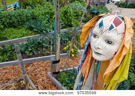 An Abstract Scuplture Of A Head In A Garden