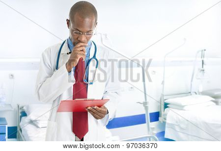 Portrait of a doctor reading a case history