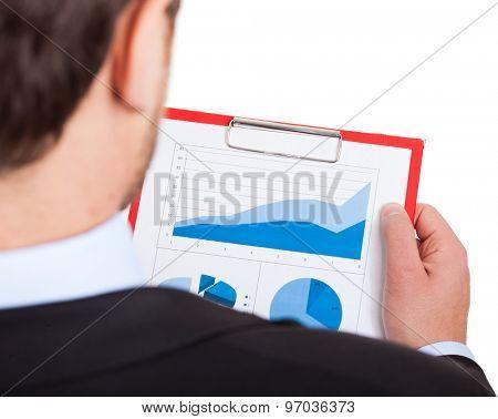 Businessman examining a financial document