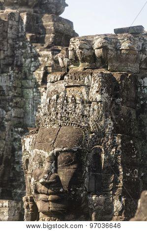 Ancient Stone Faces Of King Jayavarman Vii At The Bayon Temple, Angkor, Cambodia