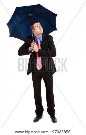 Businessman holding an open umbrella full length