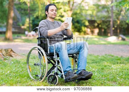 Disable man using a digital tablet