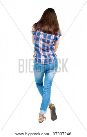 back view standing young beautiful woman. girl watching. Rear view people collection.  backside view person. Isolated over white background. young girl in blue with red stripes is bent right leg