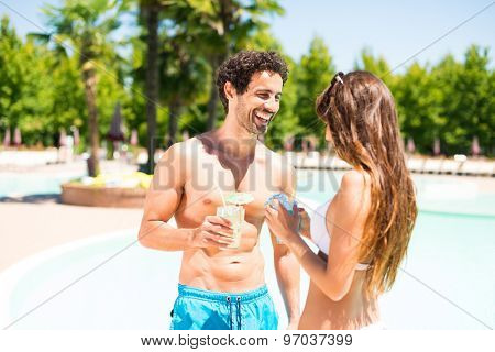 Portrait of a beautiful young couple enjoying a cocktail while talking