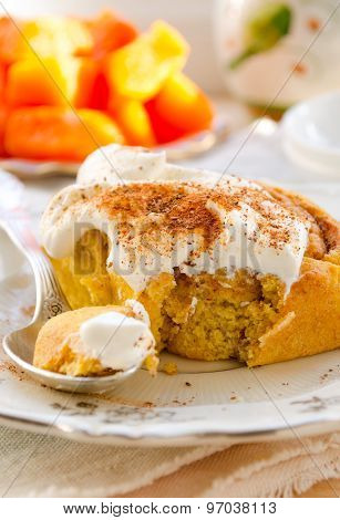 Pumpkin cinnamon rolls with spices and sweet cream