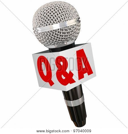 Q and A letters on a microphone box for questions and answers in an interview or broadcast reporter discussion