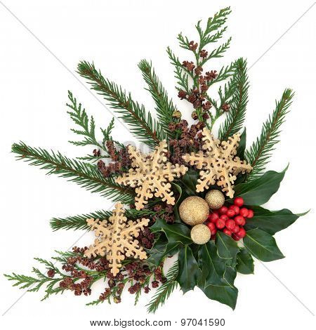 Christmas flora with gold snowflake and sparkling baubles with holly, ivy, fir and cedar cypress over white background.