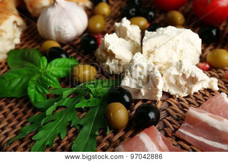 Ingredients of Mediterranean cuisine, on wooden board, top view