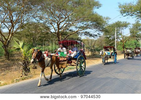 Tourist visit temples on carriage in Bagan