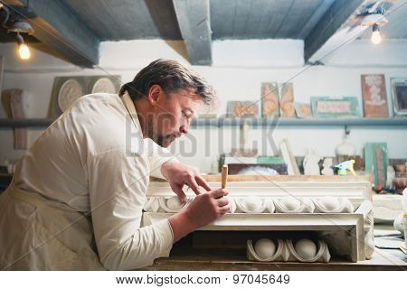restorer making his work at workshop