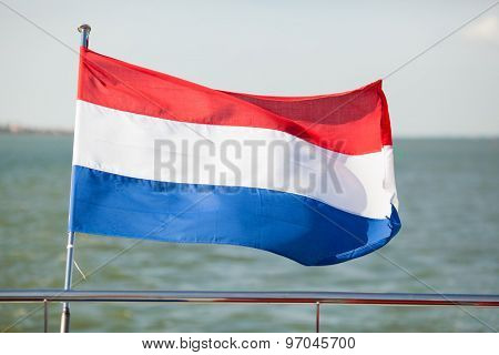 flag of the Netherlands waving on poop