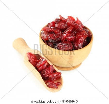 Dry dogwood fruits in wooden bowl, isolated on white