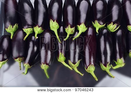Heap of fresh eggplants close up