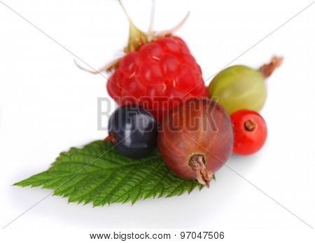 Heap of fresh berries with green leaf isolated on white