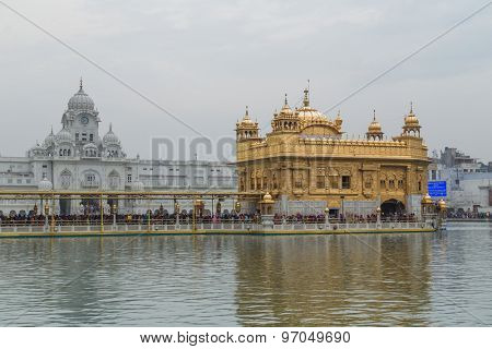 AMRITSAR, INDIA - 01 MARCH 2015: Pilgrims at Golden Temple, the holiest Sikh gurdwara in the world.
