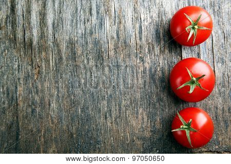 Cherry tomatoes on wooden background