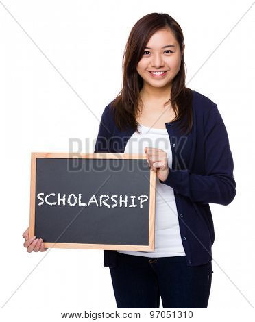 Woman showing the chalkboard with a word scholarship