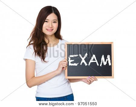 Woman with the chalkboard showing a word exam