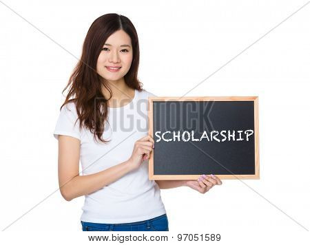 Woman with the chalkboard showing a word scholarship