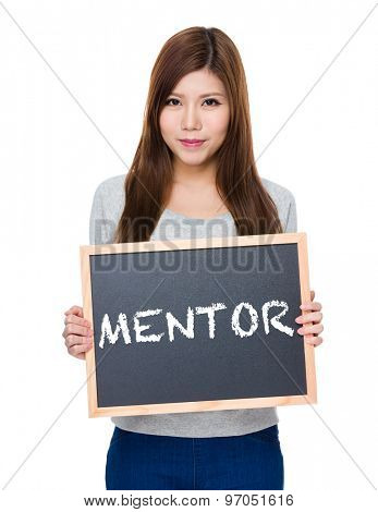 Asian woman hold with blackboard showing a word mentor
