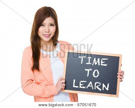 Woman hold with blackboard showing phrase of time to learn