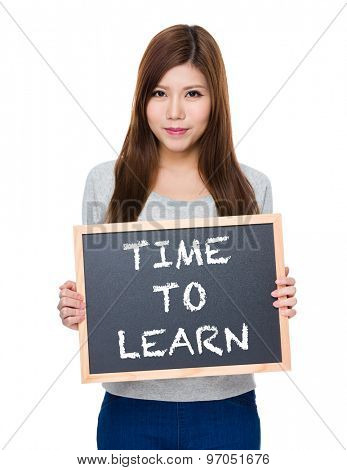 Asian woman hold with blackboard showing phrase of time to learn