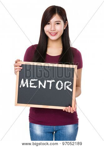Asian woman with chalkboard showing a word mentor