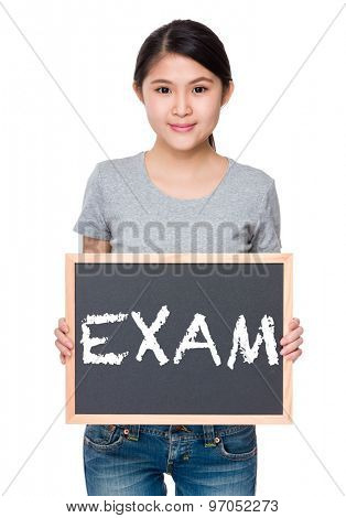 Woman hold with chalkboard and showing a word exam