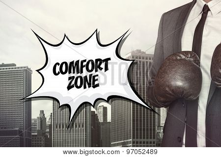 Comfort zone text with businessman wearing boxing gloves