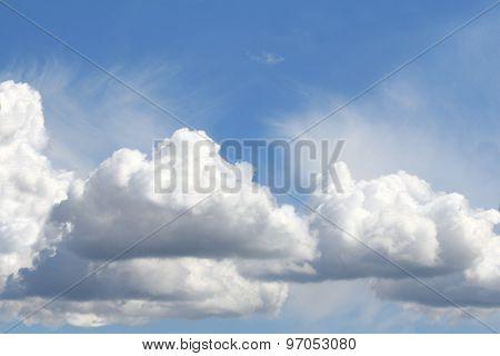 In The Blue Sky Floating Cumulus Clouds
