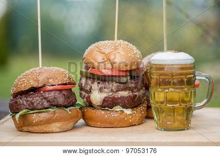 Tasty grilled burger and glass of cold beer.