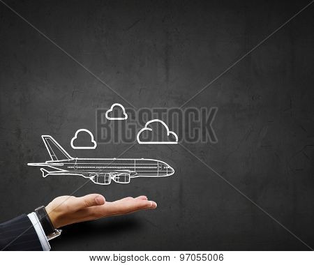 Close up of businessman hand holding airplane sign