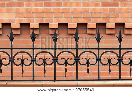 Metal Wrought Iron Fence On Wall Background