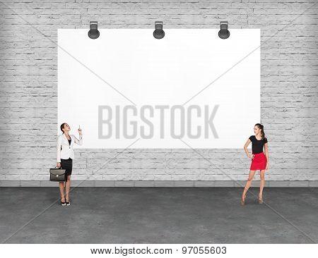 Business person near a blank  billboard