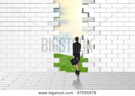 Beautiful businesswomen watching dilapidated brick wall