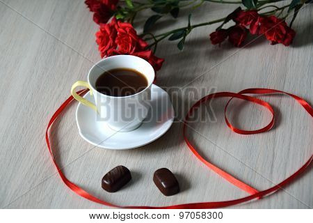 Cup Of Black Coffee With Two Oval Bonbons