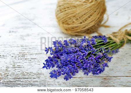 Fresh lavender and rope on wooden background